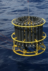 This is a CTD, an electronic instrument commonly used by oceanographers that continuously records salinity by measuring conductivity, temperature, & depth as the instrument is lowered on a hydrowire from a ship.