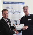 Ciarán Moody, Mitsubishi, presents Paul Olthof (Wicklow Co Co) with iPad won in draw at end of the conference!
