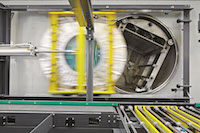The door of the giant washing machine drum is closed by a standard cylinder.